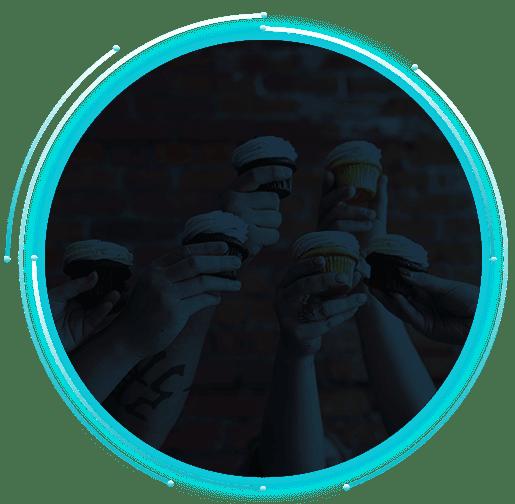 CAYK Team Members holding cupcakes